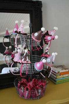 these. are. adorable. I love the party hat headbands and the stacked basket that they are displayed on!