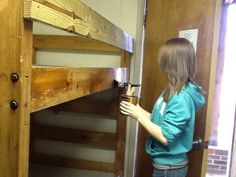 Service projects are an important part of 4-H membership.  Here Hannah is helping sand down and refresh the bunk beds that campers will sleep in this summer.