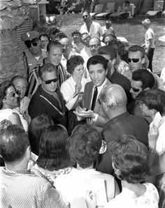 Elvis between takes on the set of his movie Viva Las Vegas in the summer of 1963 with fans.