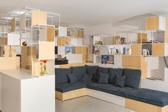 coudamy architectures has created a adaptable three-dimensional structure serving as shelving and vertical partitioning inside an apartment in paris.
