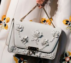 PurseBlog reviews luxury designer handbags as accessories in a daily editorial.