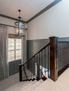 Atmosphere Interior Design: Gorgeous stairway with dark gray wainscoting. Above the wainscoting the walls are ...