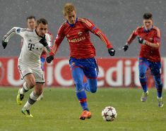 Keisuke Honda (C) of PFC CSKA Moscow in action during the UEFA Champions League Group D match between PFC CSKA Moscow and FC Bayern Muenchen at the Arena Khimki Stadium on November 27, 2013 in Khimki, Russia.