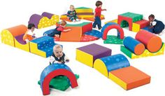 Gross Motor: Movement is key when learning how the body works. By climbing on these climbers in the picture, also used in a infant muscle room, children learn gross motor skills.