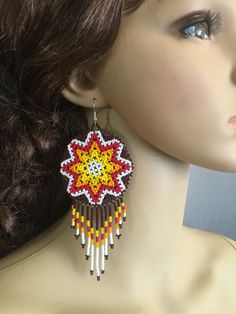 A personal favorite from my Etsy shop https://www.etsy.com/listing/477280080/huichol-long-beaded-medallions-earrings