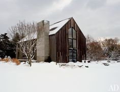 The rustic exterior of Le Pain Quotidien CEO Vincent Herbert's weekend house is covered in siding salvaged from a 200-year-old Canadian barn.