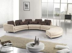 curved unique sectional sofas in modern living room ideas plus long beige rug plus round coffee table and white floor lam