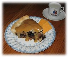 A slice of New-Fangled Mince Pie exclusive to the Middle-earth Network---with sauce and cheese.