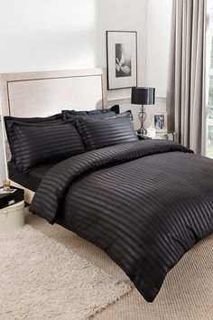 Black Satin Stripe Complete Set Single £17.00 Simple yet elegant design available in black or mink. Available in complete sets (duvet cover and fitted sheet), single with 1 pillowcase, double and king size with 2 pillowcases. 100% polyester. Machine washable. Button fasteners.