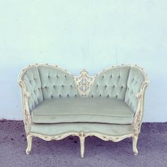 sadie settee: sea foam green velvet tufted french settee with distressed white wooden frame.