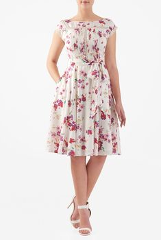 Floral print cotton cambric with pintuck pleat front and lace trim adds fresh energy to our fit-and-flare dress cinched in with a waist-defining removable sash tie belt and flared skirt.