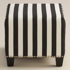 Featuring a bold, black and white stripe pattern, our plush, custom-made ottoman…