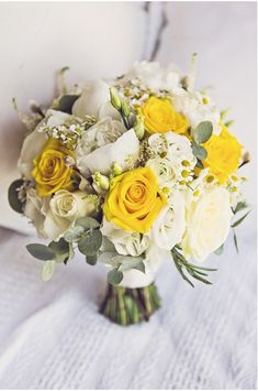 gorgeous summer wedding bouquet in white with pops of yellow. Love the seeded eucalyptus in there for greenery