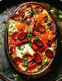 Rick Stein's Flamenco eggs with tomato and Serrano ham is what you might call Spain on a plate – a sum-up dish of everything we love about Spanish cooking: serrano ham, chorizo, pimentón, tomatoes, garlic and onion. To these basic ingredients he's also added green beans and peas in this recipe from Rick Stein's Long Weekends, and you could also add sliced, cooked new potatoes or chickpeas or the big butter beans called judión.