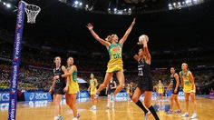 Australian captain Laura Geitz desperately attempts to block a shot by New Zealand's Maria Tutaia during the final of the 2015 Netball World Cup in Sydney, Australia. Leading by twelve goals during the second quarter, Australia held on to eventually overcome their arch rivals 58-55.