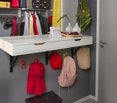Free up floor space and use a wall-mounted shelf from IKEA hung low as a hall table.