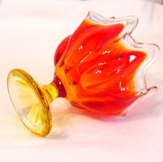 """$12 Super retro-licious Viking Glass Flame Vase! Power-packed with Persimmon Orange, the top portion of this little classic is hand swung to give the upper edges the """"Flames"""" look.  Rim is clear and the pressed glass base and lower portion is pressed.  Stands about 6 inches tall, so perfect for maximum vintage appeal while decorating in small spaces. Recommended for window sills and small well-lit spaces which need a little """"something."""""""
