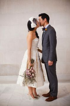 How cute is the bride's bow topped birdcage veil? And how gorgeous is her wedding dress? And how sweet is this kiss?!