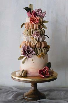 wedding cake designers white cake with macaron tower decorated with flowers winifred kriste cake We gathered together perfect wedding cake designers in order you can find the best cake for your reception. Get inspired with these amazing wedding cakes! Wedding Cake Decorations, Wedding Cake Designs, Amazing Wedding Cakes, Amazing Cakes, Unusual Wedding Cakes, Pretty Cakes, Beautiful Cakes, Beautiful Cake Designs, Cool Cake Designs