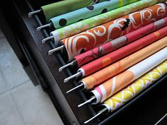 Fabric organization with file folders in a filing cabinet.  Love it!