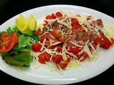 Tagliata con pomodorini e Grana Padano - Steak with cherry tomatoes and Grana Padano  Steak Restaurant