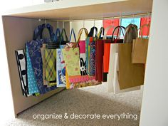 Gift bag storage using tension rod and shower curtain hooks! I need to add these hooks to the rods I have for my gift bags! It will be much easier to get the bags off the rods! Organisation Hacks, Gift Bag Organization, Gift Bag Storage, Craft Storage, Organizing Gift Bags, Storage Ideas, Shower Curtain Hooks, Creative Storage, Creative Ideas