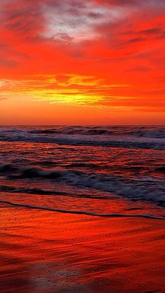 Beautiful sunrise sunset over ocean, orange beach reflection