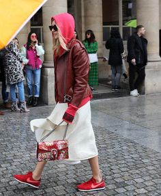 Camille Charrière in a Sportmax jacket, Céline skirt, Nike sneakers, and Gucci bag