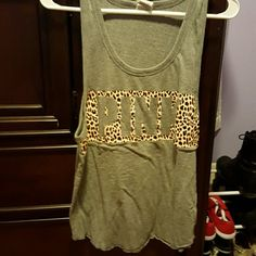 Cheetah Tank From Pink. Gray with cheetah print. Really comfy, just don't like how far the arms holes go. I only wore it once and it was over a bathing suit. No trades. PINK Victoria's Secret Tops Tank Tops