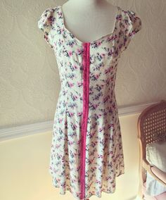 Rose print dress. Hook & Eye fastened front, lined, tie back ribbon around waist, U-neck line ~ Size Small • $28.00 + shipping.