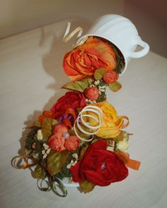 Flying Flower Cup. Used materials:silk flowers, wine corks, decorative moss, beads.