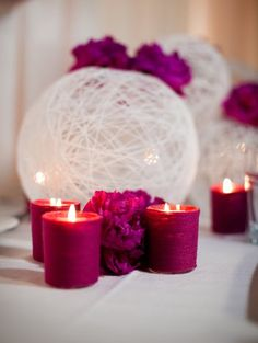 Gorgeous Centerpiece Orbs (wrap string around balloons, spray with fabric stiffener, let dry than pop the balloon.