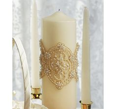 The Beverly Clark Luxe Unity Candle is embellished with elaborate beading and delicate details, giving it the allure of vintage inspired lace – a pretty accessory to match almost any wedding theme.