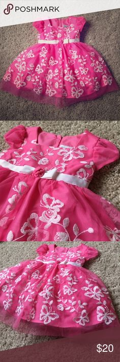 PINK EMBROIDERED DRESS 6M This adorable pink baby dress was bought and forgotten about after we moved houses. Brand new cute short sleeve dress with soft layers! Pink with white flowers and butterflies. A mock bow is centered at the waists! Dresses Formal
