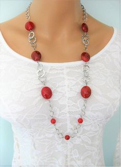Long Red Beaded Necklace handmade by Ralston Originals. This red necklace has large chunky red acrylic beads. The use of acrylic beads makes this necklace lighter weight. The necklace includes large silver metal rings, and chunky silver metal chain. This red necklace is 32 inches