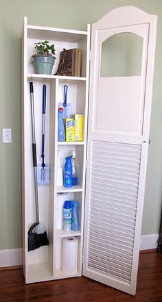 cleaning closet made from an old shutter