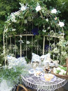 enchanted shabby chic garden, romantic, I also have the beautiful grate, paint that white, add lights and flowers for a backdrop behind furniture in booth Jardin Style Shabby Chic, Shabby Chic Porch, Gazebos, Good Vibe, White Gardens, My Secret Garden, Outdoor Rooms, Outdoor Dining, Dream Garden