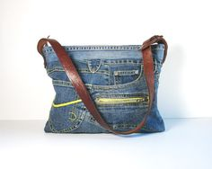 upcycled denim bag with embossed leather belt strap.