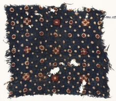 2nd half 10 c.-15 c. Textile fragment with dots and rosettes Fustat, Egypt(find spot); Gujarat, India(probable place of creation). Cotton, block-printed with mordant, dyed red and brown, and resist-dyed blue. Dimensions 19.5 x 17 cm (length x width); along length/width 17 / 17 threads/cm (thread count) Accession no. EA1990.1093