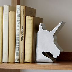 Silver unicorn profiles resist the urge to fly off the shelf. Crafted of resin with silver foil covering, whimsical bookends also work magically as table accents.