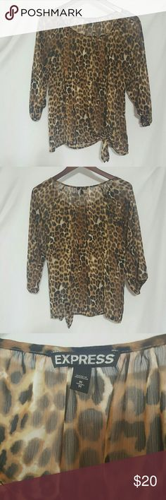 🌻SALE🌻Express Leopard Print Blouse 🌻WEEKEND SALE🌻 Excellent worn condition, like new. Super comfy sheer top 100% polyester. This super cute top ties at the left side bottom  & 3/4 elastic arm sleeves. Looks awesome with black shorts for the weekend or pants  for the work place. From a smoke free home. Any reasonable offer will be considered. Express Tops Blouses