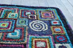 rug hooking and square within squares colourplay... yup....