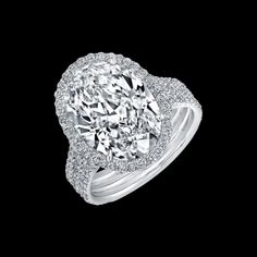 Norman Silverman Oval Cut Diamond set in three-wire Pavé Platinum Engagement Ring available at TWO by LONDON!
