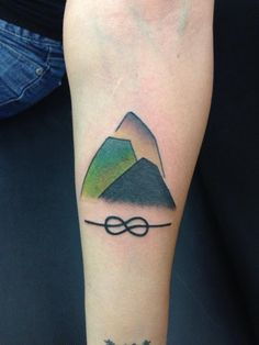 My mountain tattoo and the eight knot my passion for rock climbing.
