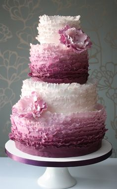 Three-tier ruffled ombre wedding cake made by 'Cake! by Sarah Small'. Find us at www.choosecake.co.uk.