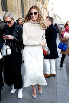 Leave it to Olivia to layer flared light-wash jeans and a colorful | Olivia Palermo's Style at Fashion Week Fall 2015 | POPSUGAR Fashion Photo 1