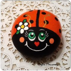 A pudgy little ladybug rock painted by Phyllis Plassmeyer