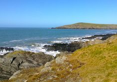 Gwbert is a small cliff top coastal hamlet overhanging the broad mouth of the Teifi river and Cardigan Bay