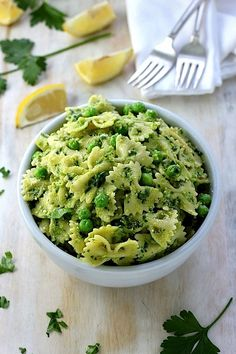 Farfalle with Peas, Parsley, and Parmesan - the perfect 15 minute meal! Easy, flavorful, and healthy!