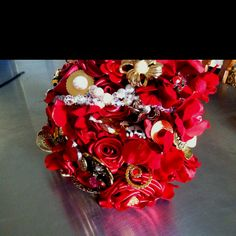 The beautiful bouquet my mom made for my brothers wedding. All the flowers are made out of ribbon